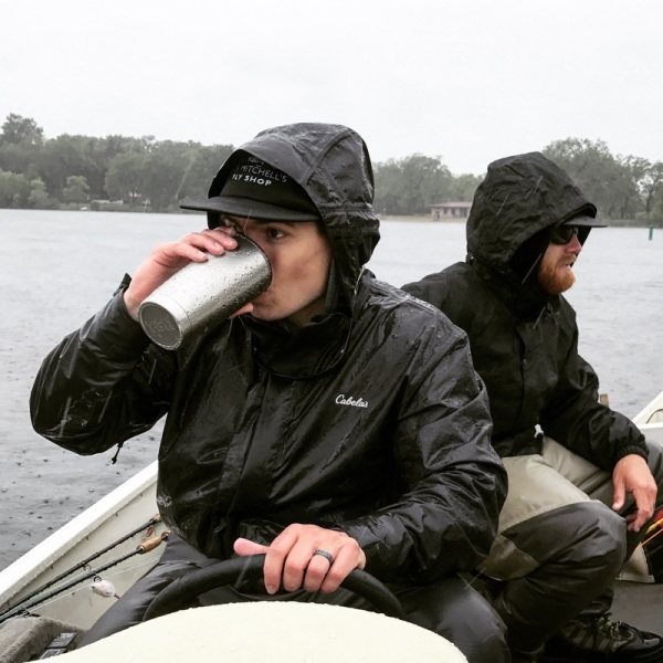 fishing on a boat in the rain with rain gear