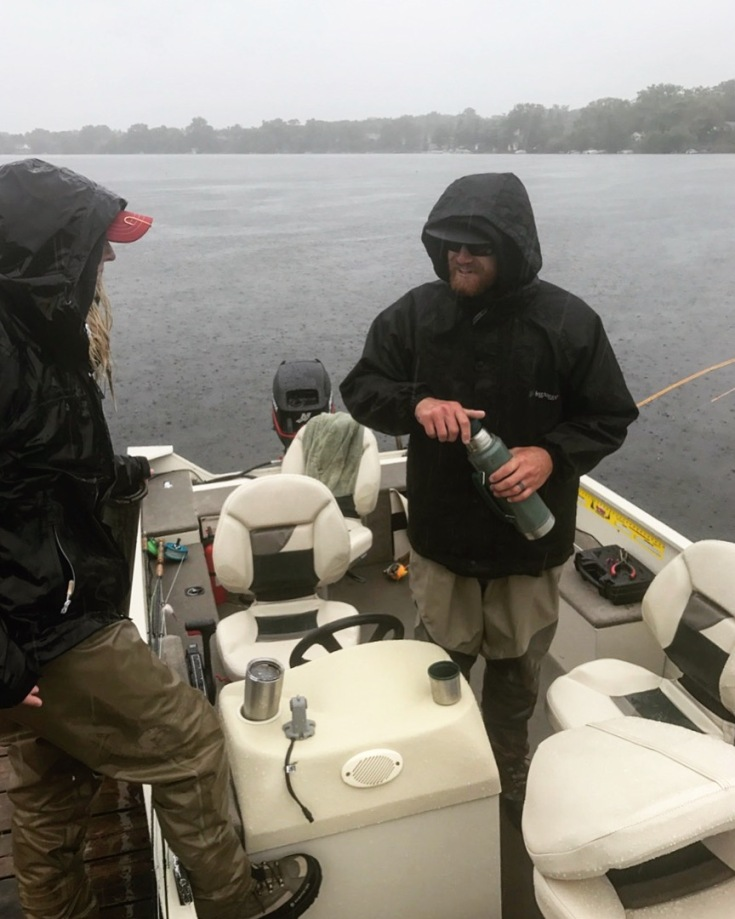fishing in the rain and preparing boat