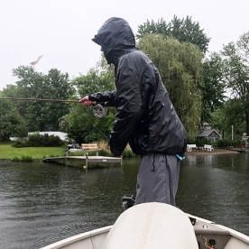 fly fishing in the rain from boat